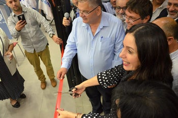 Minister Regev cuts a ribbon during a visit to Migdal Ha'Emek in northern Israel.