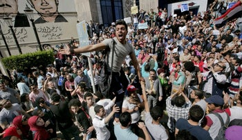 Egyptians shout slogans against Egyptian President Abdel-Fattah el-Sissi during a protest against the decision to hand over control of two strategic Red Sea islands to Saudi Arabia in front of the Press Syndicate, in Cairo, Egypt.