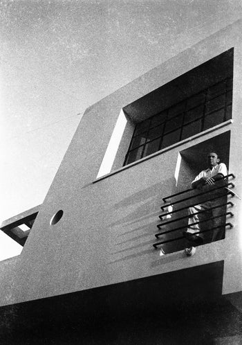 Israeli artist Arieh Lubin in a building designed by architect Sam Barkai, 1937.