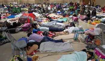 Hundreds of people gather in an emergency shelter at the Miami-Dade County Fair Expo Center on September 8, 2017 ahead of Hurricane Irma.
