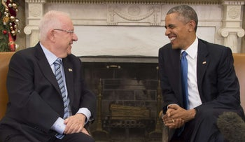 U.S. President Barack Obama talks with Israeli President Reuven Rivlin during a bilateral meeting at the white House in Washington, DC, December 9, 2015.