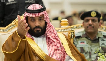 Saudi Crown Prince Mohammed bin Salman gestures during a military parade by Saudi security forces in Mecca, Saudi Arabia on August 23, 2017.
