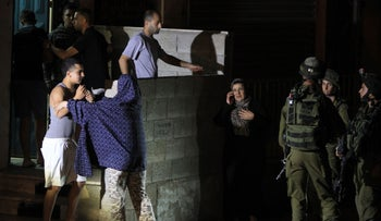 Israeli soldiers during a raid on the Jalazun refugee camp, June 16, 2014.
