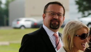 Then-White House adviser Sebastian Gorka waits with Kellyanne Conway for President Donald Trump to board Air Force One. Joint Base Andrews, Maryland. July 25, 2017