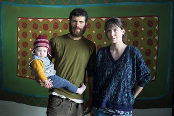 Amit Pompan, Adi Segal and their daughter Aluma pose for a photo.
