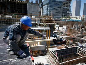 A Chinese construction worker in Tel Aviv. Last year, Chinese workers earned an average monthly salary of 24,000 shekels ($6,220).