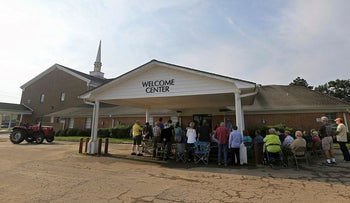 Members of the Pine Forest Baptist Church hold Sunday services in the parking lot outside their damaged church, in the aftermath of Tropical Storm Harvey in Vidor, Texas, Sunday, Sept. 3