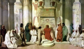 A painting depicting Joseph interpreting the dreams of Pharaoh, who is sitting on a stone throne in a palace, surrounded by people. By Jean-Adrien Guignet, 1816-1864.