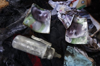 File photo: Photos of a one-and-a-half year old boy, Ali Dawabsheh, lie in a house that had been torched near the West Bank city of Nablus, July 31, 2015.
