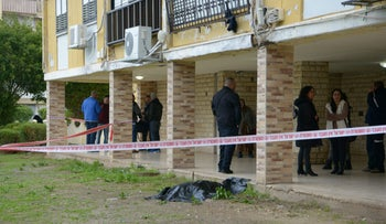 The body of a woman outside a building on Golani Brigade Street in Acre, January 4, 2017.