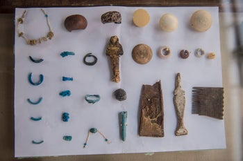 A picture taken on September 9, 2017 shows ornaments recovered at the site of a newly-uncovered ancient tomb for a goldsmith dedicated to the ancient Egyptian god Amun, in the Draa Abul Naga necropolis on the west bank of the ancient city of Luxor, which boasts ancient Egyptian temples and burial grounds.
