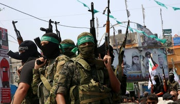 Hamas militants attend the funeral of a border security guard Nidal al-Jaafari in Rafah refugee camp, Gaza Strip, Thursday, Aug. 17, 2017.