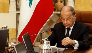 Lebanon's President Michel Aoun and Prime Minister Saad al-Hariri (L) attend the first meeting of the new cabinet at the presidential palace in Baabda, Lebanon January 4, 2017.