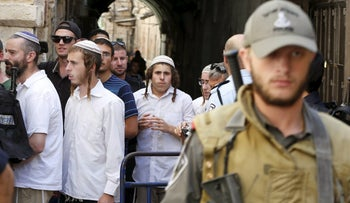 FILE PHOTO: Policemen guard as Jewish youths leave Temple Mount, in Jerusalem's Old City. September 22, 2015.