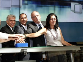 Shmuel Hauser, chairman of Israeli Securities Authority, third from right, Tel Aviv, Sep 8, 2014.