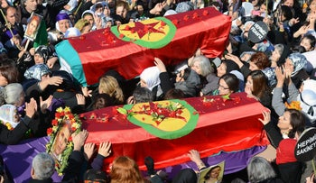 People carry the coffins, covered with PKK flags, of three Kurdish activists as tens of thousands of people gather for their funeral in Diyarbakir, Turkey, January 17, 2013.