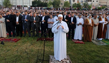Senior Hamas leader Ismail Haniyeh leads the morning prayers for Eid al-Fitr celebrations, which marks the end of the holy fasting month of Ramadan, in Gaza City July 6, 2016.