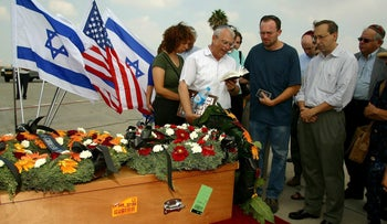 Relatives mourn next to the coffin of Marla Bennett, who was killed in an attack on the Hebrew University in Jerusalem, at her funeral in Tel Aviv, Israel, August 4, 2002.