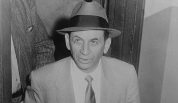 Meyer Lansky at a New York City police station, where he is being booked for vagrancy, 1958.