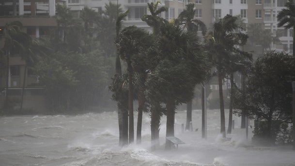 Water flows out of the Miami River to flood a walkway as Hurricane Irma passes through on September 10, 2017 in Miami, Florida.