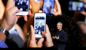 FILE - In this Wednesday, Sept. 7, 2016, file photo, Apple CEO Tim Cook announces the new iPhone 7 during an event to announce new products, in San Francisco. Apple is expected to demand $1,000 for the fanciest iPhone that it has ever made