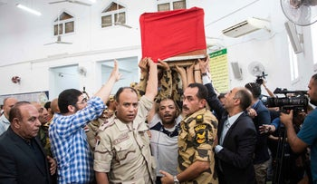 Men carry the coffin of an Egyptian soldier killed in a previous Islamic State attack in the Sinai Peninsula during a funeral ceremony north of Cairo on Saturday July 8, 2017.