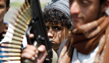 An armed youth loyal to the Houthi movement takes part in a protest against the Saudi-backed exiled government, Sanaa, Yemen August 25, 2016.