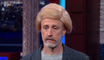 Jon Stewart with a Trump wig on the Late Show.