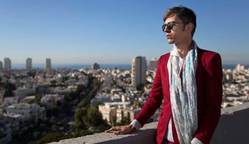 Iranian poet and writer Payam Feili looks out at the Tel Aviv cityscape, December 10, 2015.