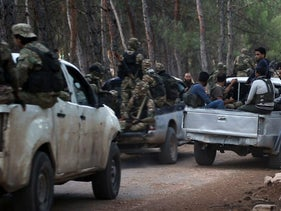 Al-Qaida-linked fighters gathering ahead of raids in the northwestern Syrian city of Idlib, hunting for members of the Islamic State group.