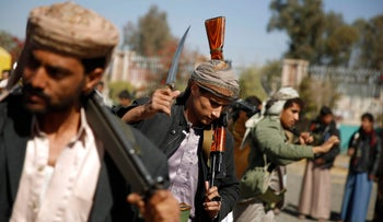 Shi'ite fighters, known as Houthis, perform a traditional dance during a tribal gathering showing support to the Houthi movement in Sana'a, Yemen, Dec. 10, 2015.