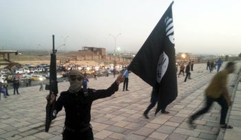 An Islamic State fighter celebrates in Mosul on June 23, 2014.