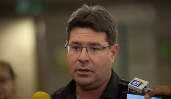 Science, Technology and Space Minister Ofir Akunis talks to the press in Tel Aviv, March 9, 2016.