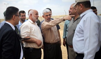 Hamas chief in Gaza Yehya Al-Sinwar gestures as he visits the border with Egypt, in Rafah in southern Gaza Strip July 6, 2017.
