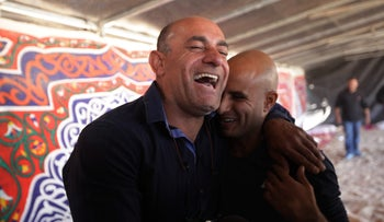 Ouda Tarabin, who was released from Egyptian prison after 15 years, meets Azzam Azzam, who was also held by Egypt for nearly eight years.