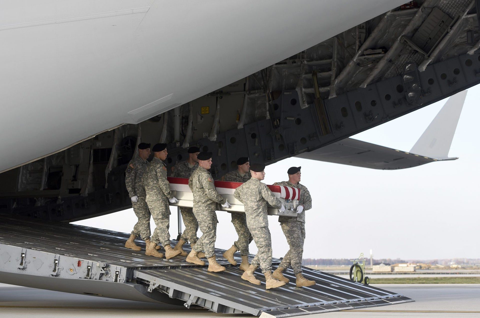 An Army carry team moves a transfer case containing the remains of Pfc. Tyler R. Iubelt at Dover Air Force Base, Del., Tuesday, Nov. 15, 2016. According to the Department of Defense, Iubelt, 20, of Tamaroa, Ill., died Nov. 12 of injuries sustained from an improvised explosive device in Bagram, Afghanistan while supporting Operation Freedom's Sentinel.
