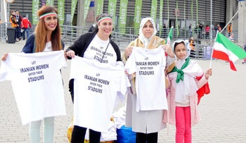 Women hold t-shirts as they protest for Iranian women's rights to enter stadiums in Iran, ahead of the FIVB Volleyball World League match between Poland and Iran, at Atlas Arena in Lodz, Poland June 17, 2017.