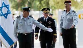 U.S. Chairman of the Joint Chiefs of Staff, General Martin Dempsey stands next to Israel's armed forces chief Major-General Benny Gantz Tel Aviv August 13, 2013.