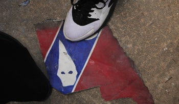 A counter-protester steps on a piece of a mock Confederate flag during a demonstration in Durham, North Carolina, U.S., August 18, 2017. REUTERS/Michael Galinsky