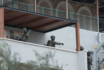 Security forces raid homes in Haifa in search of the suspected gunman behind the shooting, January 4, 2017.