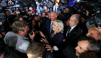 Marine Le Pen surrounded by journalists as she leaves after results in the second-round regional elections in Henin-Beaumont, France. December 14, 2015.