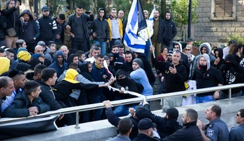 Right wing supporters of Israeli solider Sgt. Elor Azaria scuffle outside the Israeli military court in Tel Aviv, Israel, Wednesday, Jan. 4, 2017.