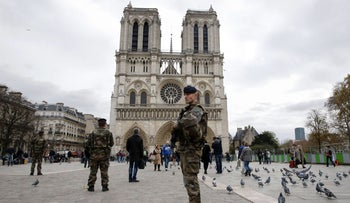 Soldiers in front of the Notre Dame Cathedral on November 16, 2015.