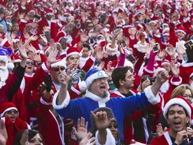 Runners dressed as Santa Claus, including 'Jewish Santa' Seth Balaban, center, gather for the 11th annual Las Vegas Great Santa Run in downtown Las Vegas, Nevada, Dec. 5, 2015.