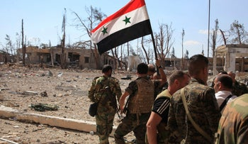 Forces loyal to Syrian President Bashar Assad walk at a military complex after they recaptured areas in southwestern Aleppo, Syria, September 5, 2016.
