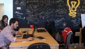 An employee works at a laptop computer at the Jerusalem Venture Partners JVP Media Labs, situated in the JVP Media Quarter in Jerusalem, Israel, on Wednesday, Oct. 21 , 2015.