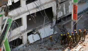 Rescue services search through the rubble after a building site collapsed in Tel Aviv, September 5, 2016.