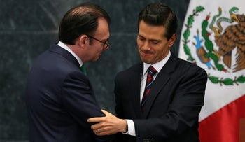 Mexican President Enrique Pena Nieto shakes hands with the country's former finance minister during the announce of new cabinet members, Mexico City, Mexico, September 7, 2016.