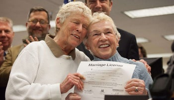 File photo: SEATTLE, WA - DECEMBER 6: Jane Abbott Lighty, left, and Pete-e Petersen embrace after receiving the first same-sex marriage license in Washington state, U.S., December 6, 2012.