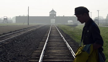 Man crosses the iconic rails leading to the former Nazi death camp of Auschwitz-Birkenau. July 29, 2016.